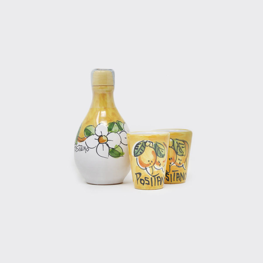 Limoncello in ampollina in ceramica con bicchieri